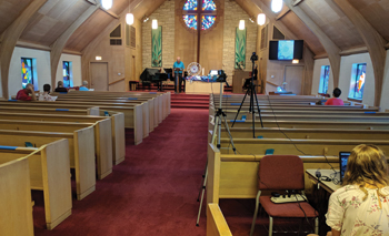 Worship leader Calvin Buller speaks at the pulpit during First Mennonite Church's Aug. 9 livestreamed worship service in Hutchinson, Kan. — First Mennonite Church